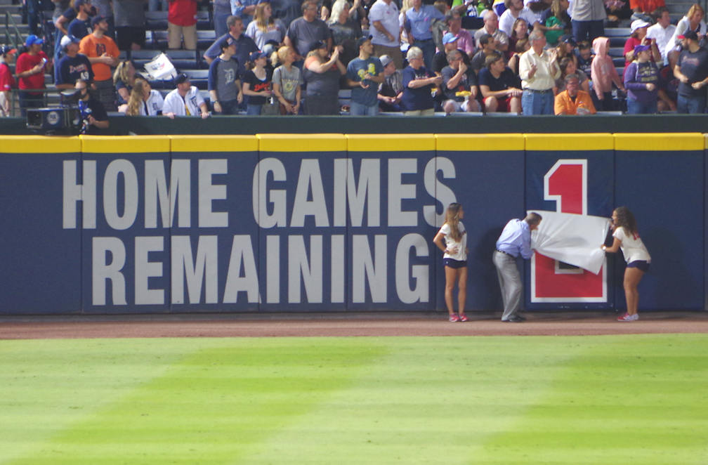 John Schuerholz participates in the countdown on October 1, indicating only one more game remains at Turner Field